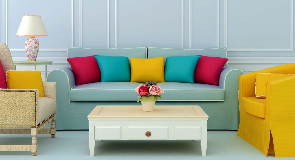 Stunning arrangement of scatter cushion on teal sofa