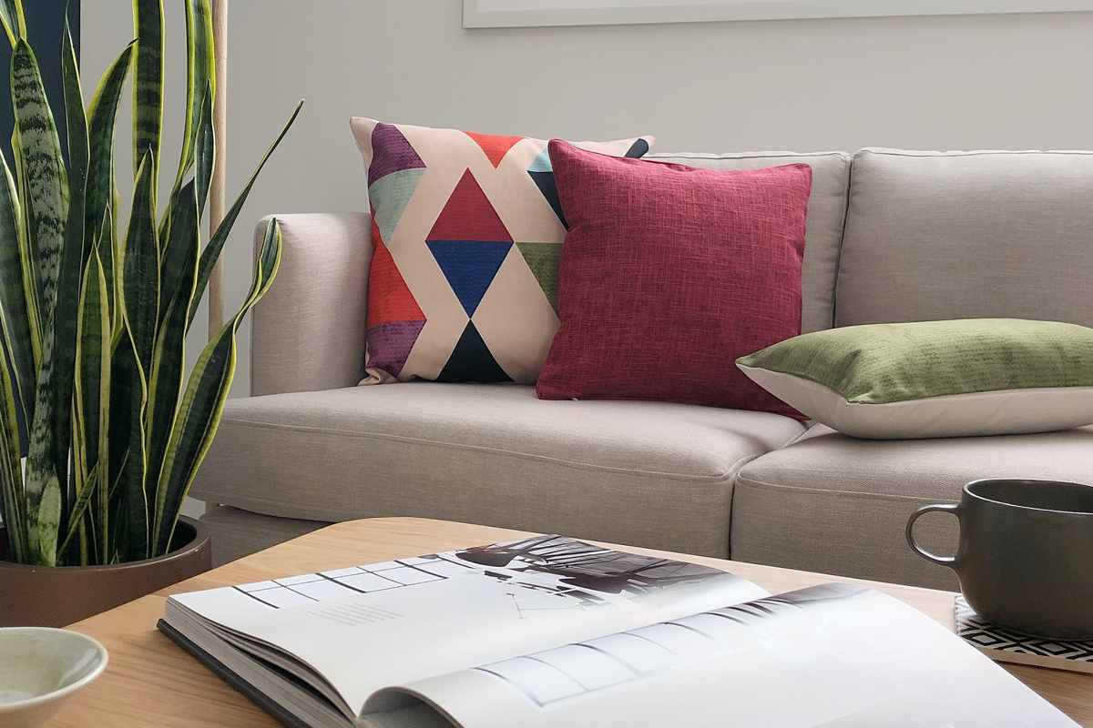 sofa with red and green pattern cushions rh simplycushions com au