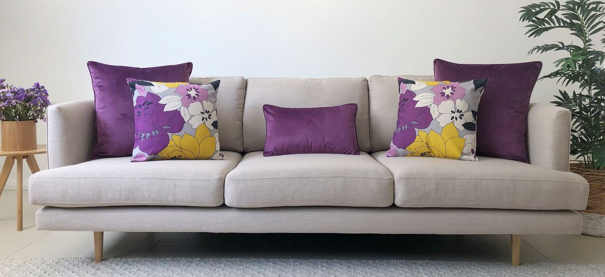 Grey Sofa With Purple And Yellow Cushion Arrangement