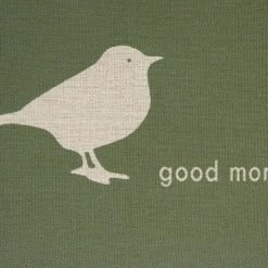 Close up of green linen cushion with 'good morning' text and bird