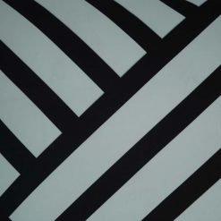 Close up of white and black cushion cover in striped print