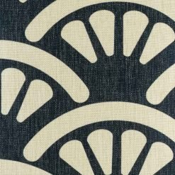 Close up view of navy cushion cover with fan pattern