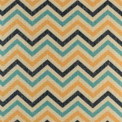 Close up of blue and yellow chevron cushion cover