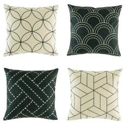 Set of 4 modern cushion covers in black with contrasting shapes