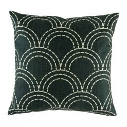Dark cushion with sweeping semi circle pattern in light colours on dark background