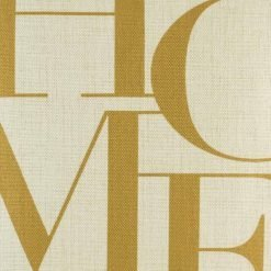 Close up of cushion with gold HOME text