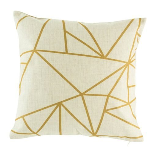 Geometric pattern in gold on cushion cover