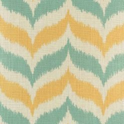 Close up of yellow and green zig zag pattern cushion cover