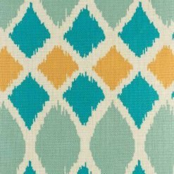 Close up of teal and orange geometric shapes on a cushion cover