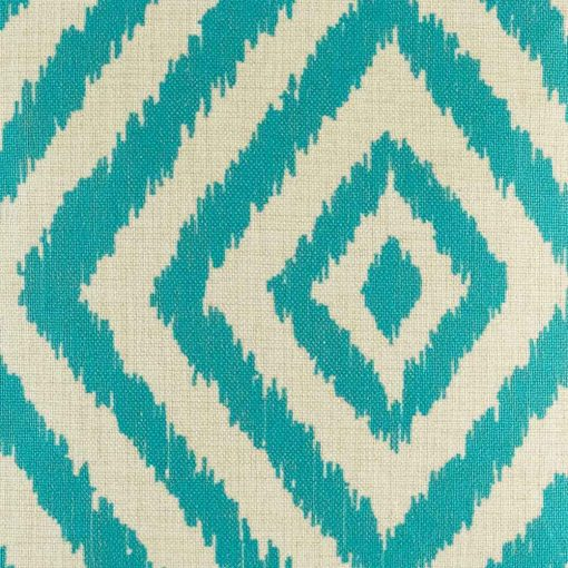 Close up view of teal coloured cushion cover with geometric shapes