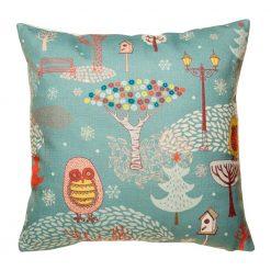 Teal coloured cushion with fun whimsical design