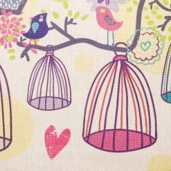 Close up of natural cushion with colourful birds and cages