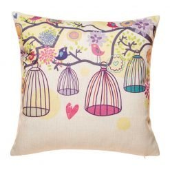 Natural cushion cover with bright coloured cages and branches