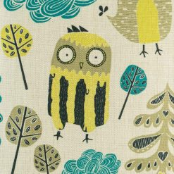 Close up of yellow owl figure on cushion cover