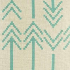 Close in view of teal double arrow heads on cushion