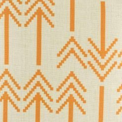 Close in view of orange double arrow heads on cushion cover
