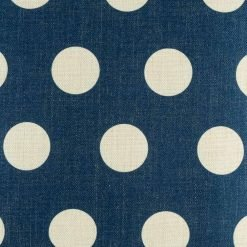 Close up of blue polka cushion cover with white polka dots