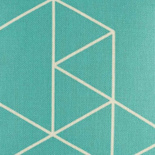 Close up showing angled pattern on teal blue central square of cushion cover