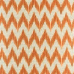 Close up view of orange zig zag cushion cover