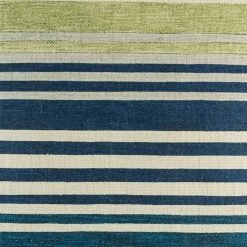 Close up of striped decorative cushion cover showing blues and greens