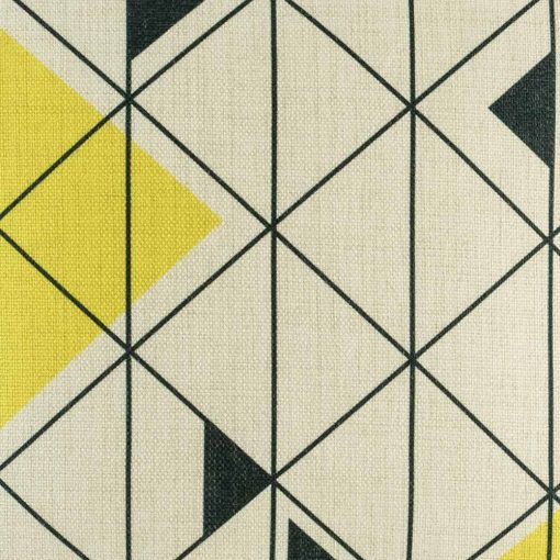 Close up of yellow triangle and black geometric design on cushion cover