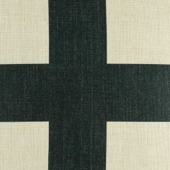 Zoomed in view of large black cross on cushion cover