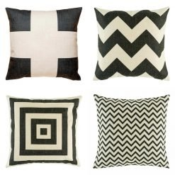 Collection of four cushion covers with black prints