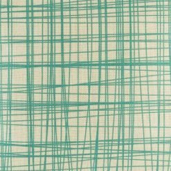 Close up of cushion with teal pattern