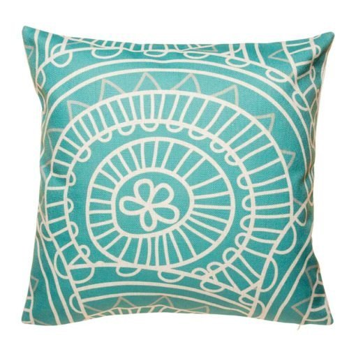 Teal coloured cushion cover with funky white pattern