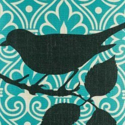 Close up of black bird motif on scatter cushion cover