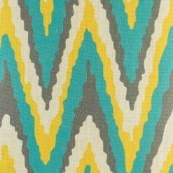 Close up of teal, yellow and grey chevron cushion cover