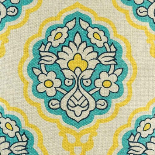 Close up of blue and yellow flower pattern on cotton linen cushion