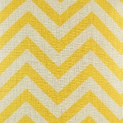 Close up view of yellow chevron design on cushion cover