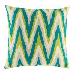 Teal and green zig zag pattern on cushion cover