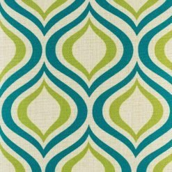 Close up of teal and green geometric shapes on cushion cover