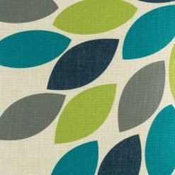 Close up of teal and green pattern on cushion cover