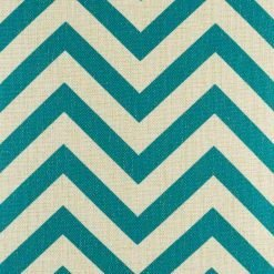 Close up of teal zig zag pattern on cushion cover