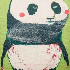 Close up of green cushion cover with panda print
