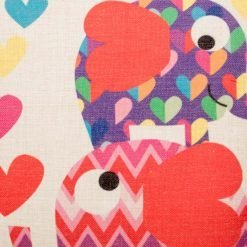 Close up of cushion cover with purple and pink Elephants