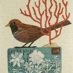 Close up of brown bird and red tree on postcard cushion