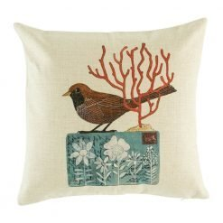 Cushion cover with brown bird and red tree on a postcard