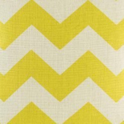 Close up of yellow zig zag pattern cushion