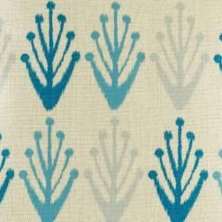 Light blue and dark blue pattern on close up of cushion