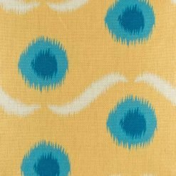 Zoomed in view of yellow cushion with blue polka dots