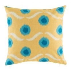 Yellow cushion cover with blue polka dots