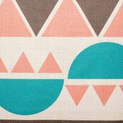 Close up view of pink and teal scatter cushion