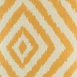 Close up of bright yellow pattern on cushion cover