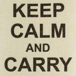 Close up of white cushion cover with black keep calm and carry on text