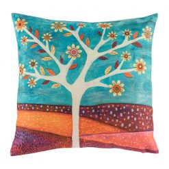 Bright colourful cushion with orange landscape and blue sky