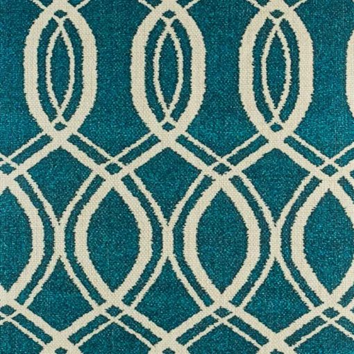 Close up of decorative cushion with swirling blue deisgn